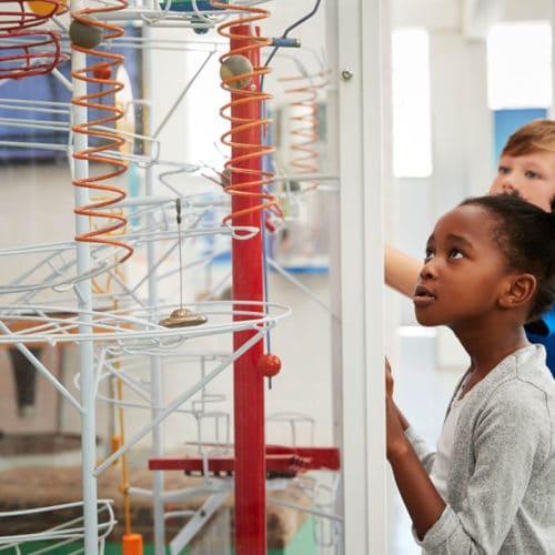 children engaging with museum exhibit